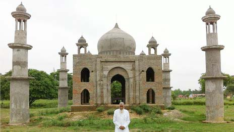 Qadri designed the building himself, clearly inspired by India's ancient monuments. But he laughed when villagers started calling it the Taj Mahal, after the mausoleum famously built by a Mughal king for his favorite wife.