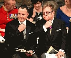 David Furnish (left) and Elton John at the wedding of Britain's Prince William and Kate Middleton, at Westminster Abbey in central London, on April 29, 2011 (AFP Photo)