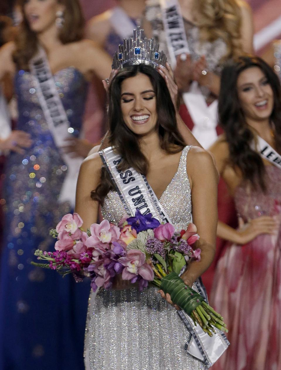 Miss Colombia Paulina Vega smiles as the the crown is placed on her head as she becomes Miss Universe.