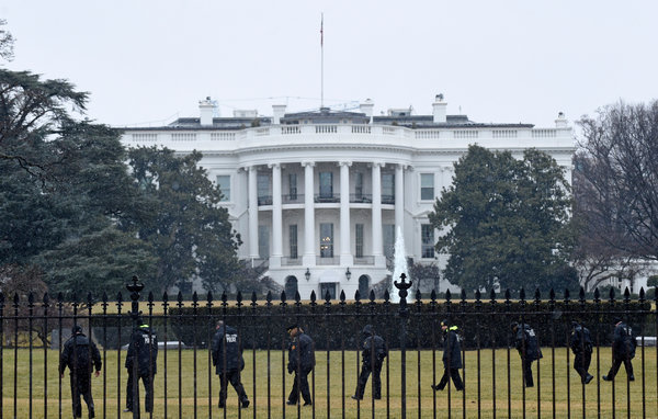 Secret Service officers searched the south grounds of the White House on Monday after a small, two-pound drone passed over the fence and crashed into a tree.