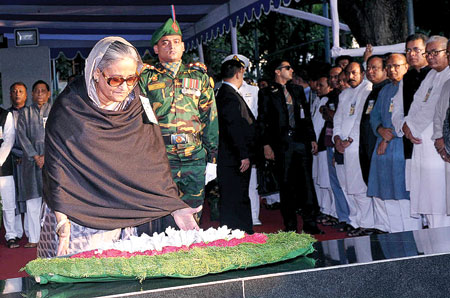 Prime Minister Sheikh Hasina paying tributes to Father of the Nation Bangabandhu Sheikh Mujibur Rahman by placing wreath at his portrait on the premises of Bangabandhu Memorial Museum in the city's Dhanmondi on Tuesday commemorating the 40th Jail Killing Day. Photo: PID
