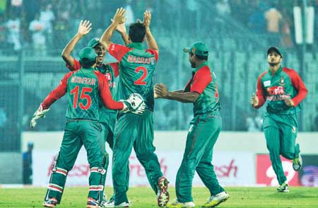 Bangladesh cricketer Al-Amin Hossain celebrates with teammates after the dismissal of unseen Indian batsman Shikhar Dhawan during the Twenty 20 match between India and Bangladesh in the Asia Cup T20 cricket tournament at The Sher-e-Bangla National Cricket Stadium in Dhaka on Wednesday.      photo: Observer