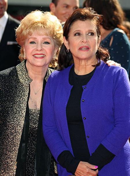 Debbie Reynolds dies grieving for daughter Carrie Fisher