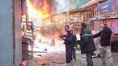 Central Baghdad blasts kill at least 18
