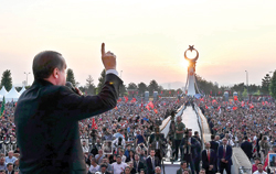 Turkish President Recep Tayyip Erdogan speaking at sunrise during the opening ceremony of the 'July 15 Martyrs' Monument' at the Presidential Complex in Ankara on July 16, as part of the events held to mark one year since the July 15 defeat of the failed coup bid.    Photo : AFP