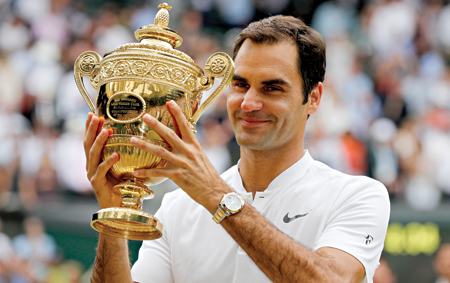Switzerland's Roger Federer holds the winner's trophy after beating Croatia's Marin Cilic in their men's singles final match, during the presentation on the last day of the 2017 Wimbledon Championships at The All England Lawn Tennis Club in Wimbledon, southwest London, on Sunday.    photo: AFP