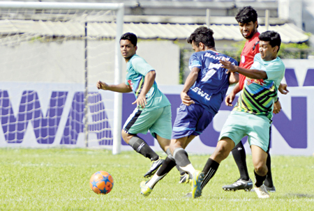 An exciting moment of a third-day match of Walton Inter-University Football Tournament on Sunday at the Bangabandhu National Stadium in Dhaka.     photo: Observer DESK