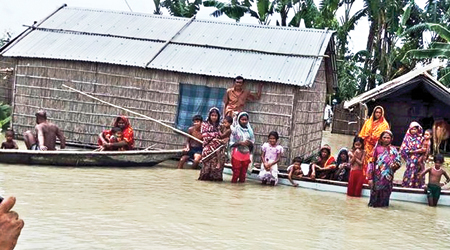 Some flood-hit families in Kurigram Sadar are waiting for relief materials on Monday. Floods in Kurigram and Lalmonirhat districts left thousands of people marooned for more than 10 days.    photo: Observer