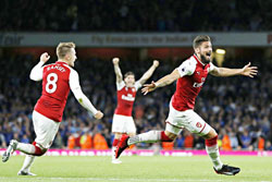 Arsenal's French striker Olivier Giroud (C) celebrates scoring Arsenal's fourth goal during the English Premier League football match between Arsenal and Leicester City at the Emirates Stadium in London on Friday. photo: AFP