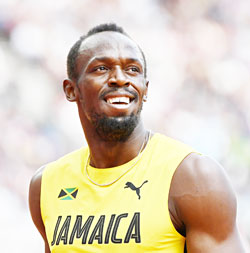 Jamaica's Usain Bolt reacts after anchoring his team to victory in their heat of the men's 4x100m relay athletics event at the 2017 IAAF World Championships at the London Stadium in London on Saturday. 	photo: AFP