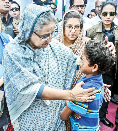 Prime Minister Sheikh Hasina becomes emotional while visiting registered Rohingya refugee camp and distributing relief materials among the refugees at Kutupalong Bazar in Ukhiya of Cox's Bazar on Tuesday.	Photo: BSS