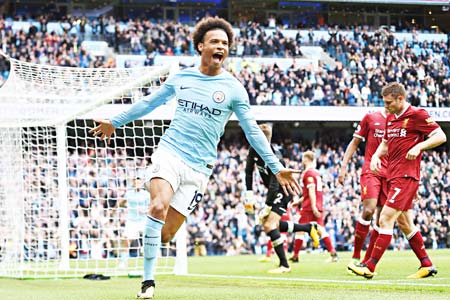 Manchester City's German midfielder Leroy Sane celebrates after scoring their fourth goal during the English Premier League football match between Manchester City and Liverpool at the Etihad Stadium in Manchester, north west England, on September 9, 2017.    photo: AFP