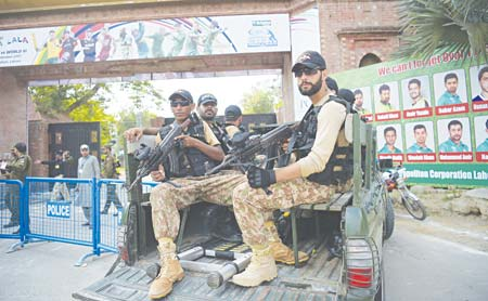 Pakistani army soldiers patrol at the main entrance of the Gaddafi Cricket Stadium in Lahore on Tuesday.    photo: AFP