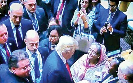 Prime Minister Sheikh Hasina speaking to US President Donald Trump on the Rohingya issue during a break at a  high-level meeting on Tuesday at the UN headquarters in New York.  TV PHOTO