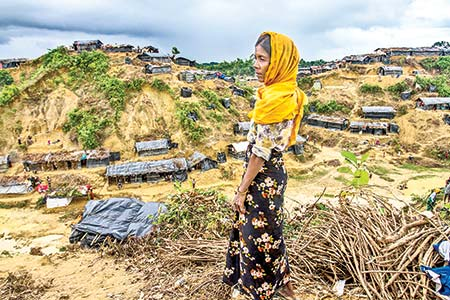 A Rohingya woman looks pale as she ponders over her future at Balukhali refugee camp in Cox's Bazar on Tuesday. A dire humanitarian situation is unfolding inside overcrowded Rohingya refugee camps in Bangladesh after the number fleeing violence in Myanmar reached near half-of-a-million. Photo: Ar sumon