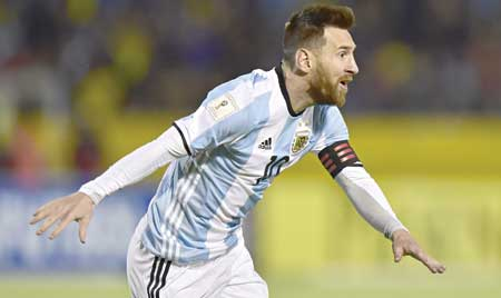Argentina's Lionel Messi celebrates after scoring his third goal against Ecuador during their 2018 World Cup qualifier football match in Quito, on Tuesday.	photo: AFP