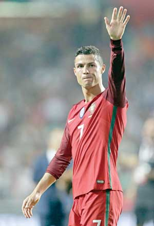 Portugal�s forward Cristiano Ronaldo waves during the FIFA World Cup 2018 Group B qualifier football match between Portugal and Switzerland at the Luz Stadium in Lisbon on Tuesday. photo: AFP