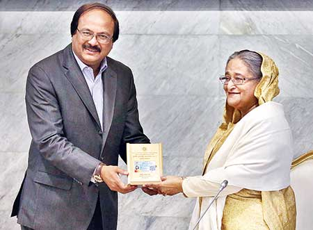 Senior Secretary of the Internal Resources Division (IRD) and NBR Chairman Md Nojibur Rahman handed over the income tax card of Prime Minister Sheikh Hasina at her office, PMO, in the city on Monday.    photo : pid