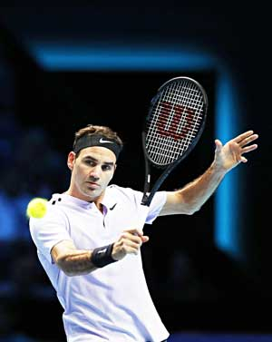 Switzerland's Roger Federer plays a backhand shot against US Jack Sock during their men's singles tennis match on Day One of the ATP World Tour Finals  tennis tournament at the O2 Arena in London on November 12, 2017.photo: AFP
