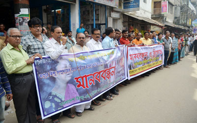 Human chain formed in Pabna against Rangpur violence