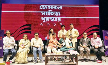 Gemcon Group Vice-Chairman Kazi Nabil Ahmed, seated, third from left, and poet Mohammad Rafique, winner of the 12th Gemcon Literary Award, seated fifth from left, along with other award winners and juries during the Gemcon Literary Award ceremony at Bangla Academy.