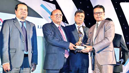 Prime Bank Company Secretary Mohammed Ehsan Habib receiving the first prize of ICSB for Corporate Governance Excellence in the banking category from Commerce Minister Tofail Ahmed, MP at an awarding ceremony at Bangabandhu International Conference Centre in the city recently.	photo: Bank