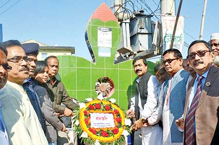 To mark the Birganj Freedom Day, Monoranjan Sheel Gopal, MP, placing wreaths on Shaheed Budharu Monument in Birganj of Dinajpur on Wednesday.     photo: Observer
