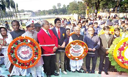To mark the Kurigram Freedom Day, wreaths are being placed on the independence monument on Wednesday.     photo: Observer