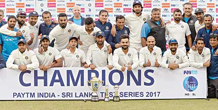The Indian cricket team pose with the trophy after winning the third Test cricket match series against Sri Lanka by 1-0 at the Feroz Shah Kotla Stadium in New Delhi on Wednesday.    photo: AFP