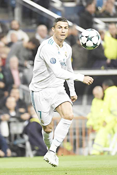 (FILES) This file photo taken on October 17, 2017 shows Real Madrid's Portuguese forward Cristiano Ronaldo during the UEFA Champions League group H football match Real Madrid CF vs Tottenham Hotspur FC at the Santiago Bernabeu stadium in Madrid on October 17, 2017.     photo: AFP