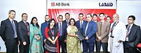 AB Bank Deputy Managing Director and Head of HRMD Shamshia I Mutasim and Labaid Hospitals COO Al Emran Chowdhury exchanging documents after signing an agreement at the bank's head office in the city on Sunday.	photo: Bank
