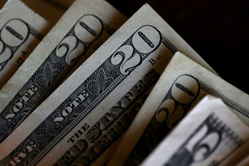 Dollar heads into 2018 on a weaker note, Asia stocks mixed