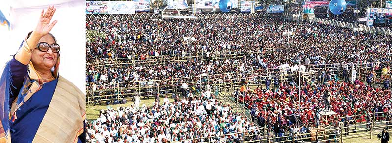 Prime Minister Sheikh Hasina waiving at the people at a public meeting organised by her party at Jessore Eidgah Maidan on Sunday. photo : BSS