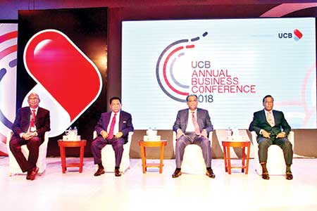 State Minister for Land Saifuzzaman Chowdhury, MP seen with others as the chief guest at the Annual Business Conference-2018 organised by UCB at Hotel Radisson Blu Dhaka in the capital on Thursday.	photo: Bank