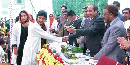 To mark the inception of Sheikh Hasina Medical College in Habiganj, local lawmaker Advocate Mohammad Abu Jahir  welcoming the freshers with flower on Wednesday afternoon.     photo: Observer