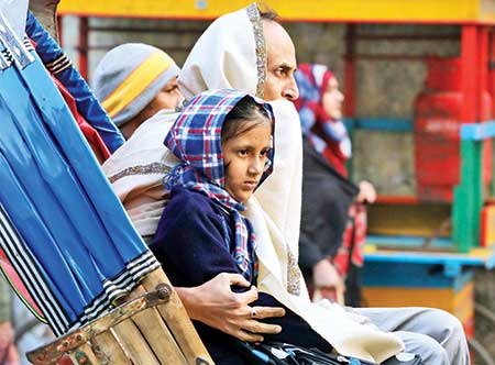 Braving severe cold, a Lakshmibazar family in Old Dhaka ventures out of doors on Saturday morning as the cold wave sweeps  across the country.photo: Observer