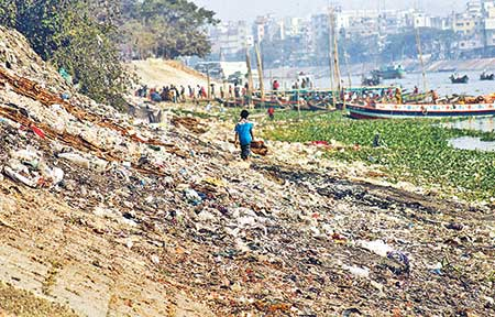 The River Buriganga, lifeline of the capital Dhaka, is gradually dying as a huge quantity of garbage is dumped into the river every day, polluting its water. Untreated chemical wastes are also being dumped (inset). The photos were taken from Kamrangirchar and Swarighat area in the capital on Friday.	Photo : Jibon Amir