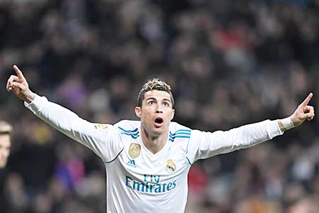 Real Madrid's Portuguese forward Cristiano Ronaldo celebrates after scoring during the Spanish league football match between Real Madrid CF and Real Sociedad at the Santiago Bernabeu stadium in Madrid on February 10, 2018.photo: AFP