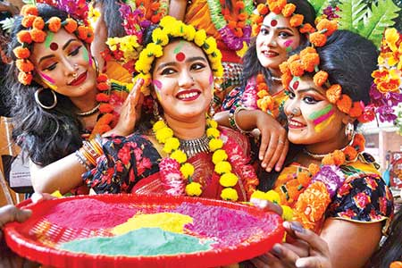 Women celebrating Pahela Falgun, the first day of spring, wearing Bashanti clothing with headgears of Marigold on Tuesday. This photo was taken from Dhaka University's Charukala Institute.    photo: Observer