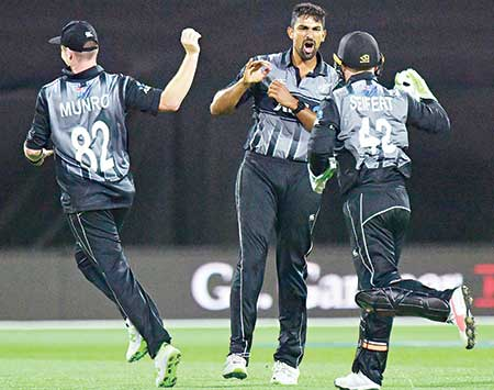 New Zealand's Ish Sodhi (C) celebrates with teammates Colin Munro (L) and wicketkeeper Tim Seifert (R) after England's Alex Hales was caught out during the first Twenty20 cricket match between New Zealand and England at Westpac Stadium in Wellington on Tuesday.     photo: AFP