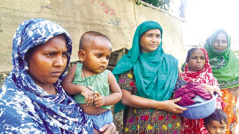 A group of stricken women at Joymonigola at Mongla in Bagerhat.	photo: Observer
