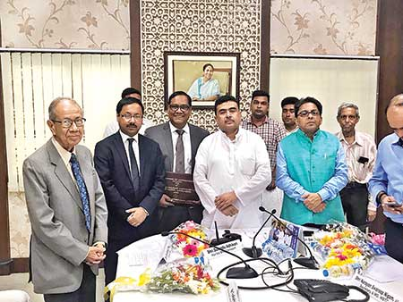 Transport Minister of West Bengal Shubhendru Odhikari, Transport Secretary Alapon Bondhopaddhay and Deputy High Commissioner of Bangladesh to India Toufik Hasan, WMS Managing Director Sakhawat Hossain and SWL Managing Director Shomdeb Chottopadhay pose during a deal signing ceremony in Kolkata on Wednesday.