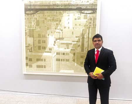 Anisuzzaman in front of his woodcut print