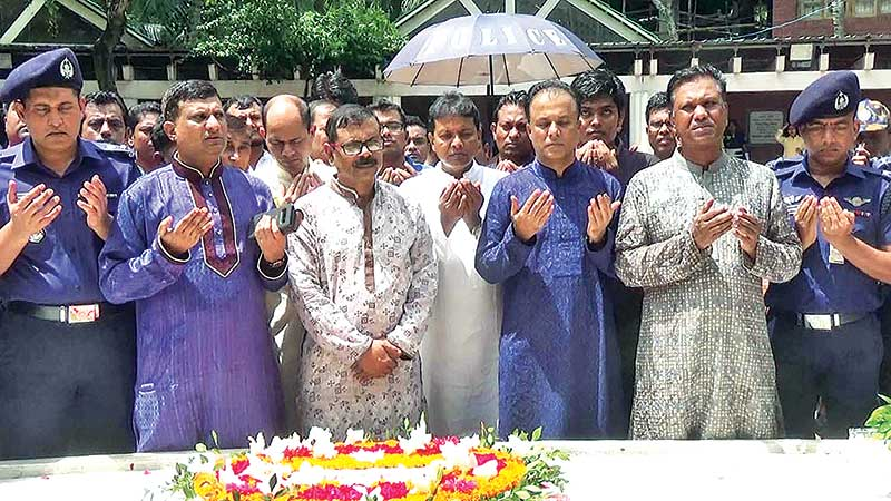 Six newly promoted DIGs offering munajat at the grave of Father of the Nation
