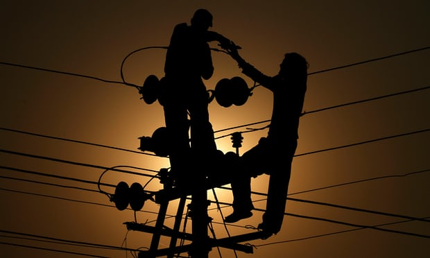 The signs indicate that people installing or fixing power lines are working in the area. Photograph: Rajesh Kumar Singh/AP