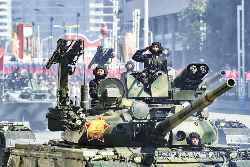 Korean People's Army (KPA) soldiers stand atop armoured vehicles during a military parade on Kim Il Sung square in Pyongyang on September 9.