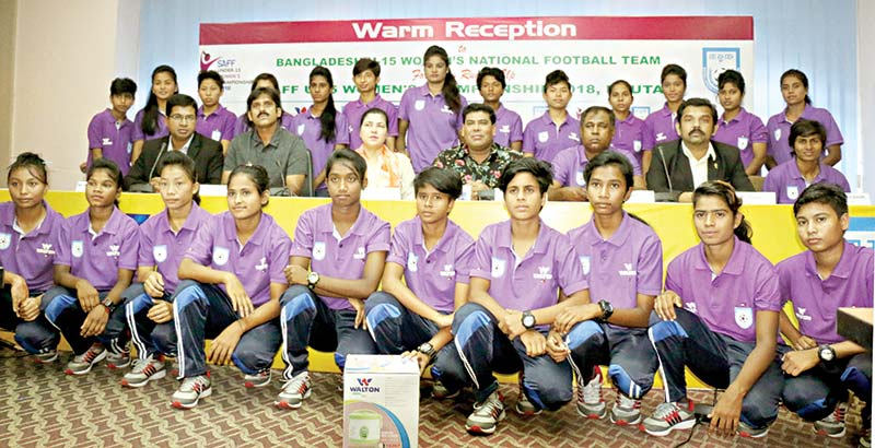 Bangladesh U-15 girls football team along with officials at a warm reception programme organised by Walton Group on Monday. 	photo: walton
