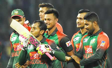 (File Photo) Bangladesh cricketer Mushfiqur Rahim (2L) kisses his bat as he celebrates their team's five wicket victory over Sri Lanka after the third Twenty20 (T20) international cricket match between Bangladesh and Sri Lanka of the tri-nation Nidahas Trophy at the R. Premadasa stadium in Colombo on March 10, 2018.	photo: AFP
