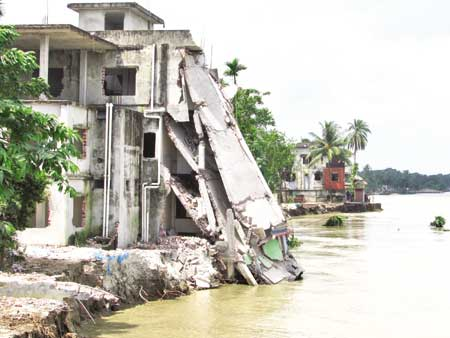 The Mulfatganj Life Care Hospital building collapsing as the River Padma erodes its banks in Naria upazila of Shariatpur district. The photo was taken on Friday.	photo: Observer