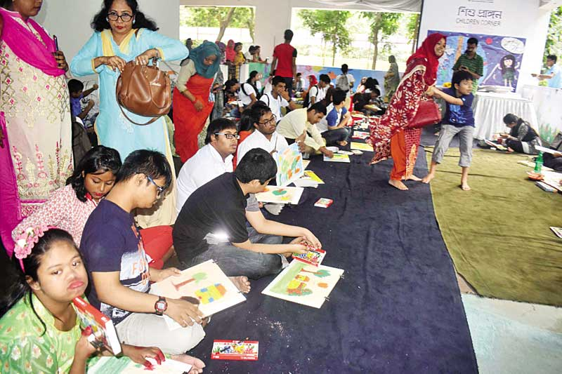Children engrossed in drawing at the competition